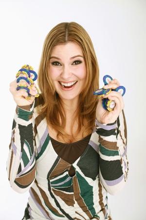 Woman holding gambling chips photo
