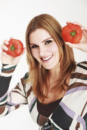 Woman holding tomatoes Stock Photo - 13384182