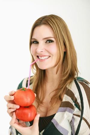 Woman drinking fresh tomato juice Stock Photo - 13384177