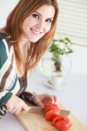 Woman slicing tomatoes photo
