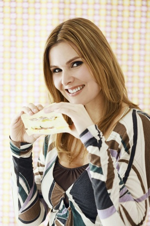 Woman eating sandwich photo