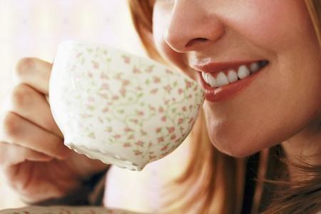 Woman enjoying a cup of tea Stock Photo - 13384151