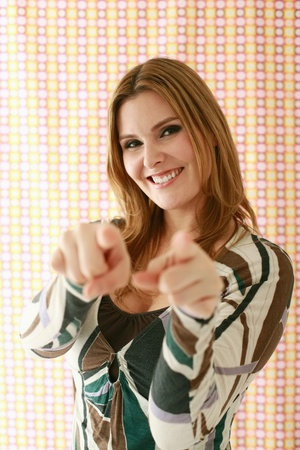 Woman pointing with fingers photo