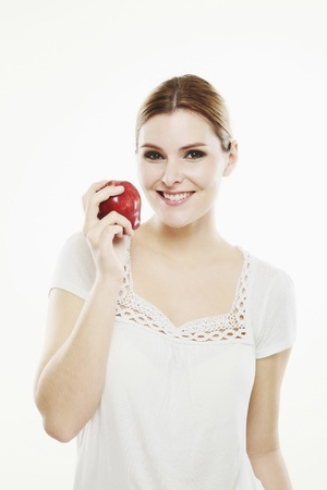 Woman holding an apple photo
