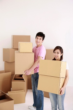 Man and woman carrying cardboard boxes photo
