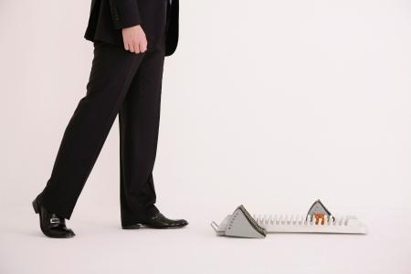Businessman walking towards starting block