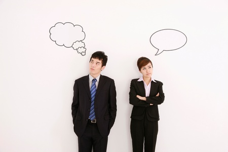 Business people with thought and speech bubble above their heads