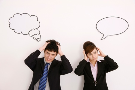 Business people with thought and speech bubble, head in hands Stock Photo