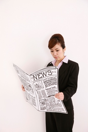 Businesswoman reading newspaper photo