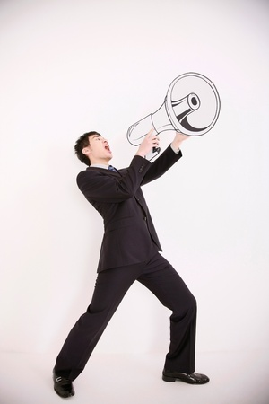 Businesswoman shouting into megaphone Stock Photo - 13384065