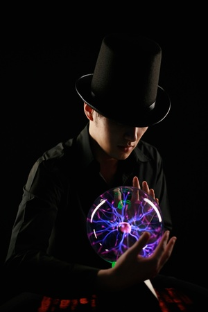 Man looking into crystal ball Stock Photo - 13383970