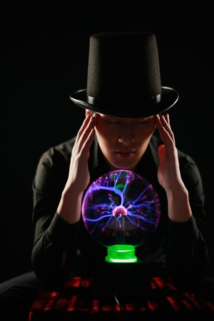 Man looking into crystal ball Stock Photo - 13383989