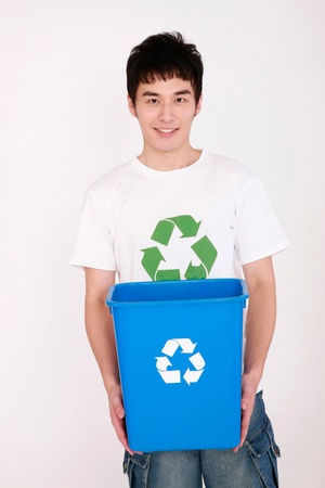 Man holding recycling bin photo