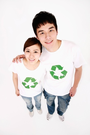 environmental awareness: Man and woman wearing t-shirts with recycling symbol smiling