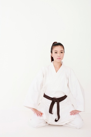 Woman in karate uniform