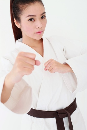 high angle shot: Woman in karate uniform