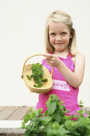 Girl collecting herbs photo