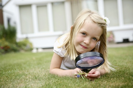 Girl with magnifying glass photo