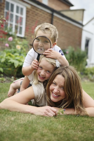 Boy and girl lying forward on woman photo