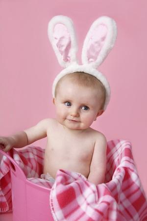 Baby boy with bunny ears photo