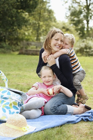 Woman and children having a picnic at the park photo