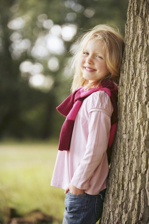 Girl posing next to a tree Stock Photo - 13568404