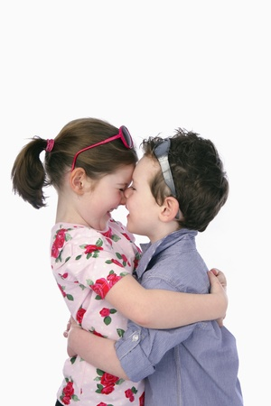 Boy and girl rubbing nose photo