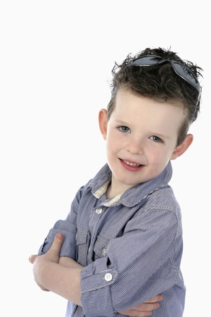 Boy with sunglasses standing with arms crossed Stock Photo - 13558052