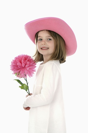 Girl with hat holding flower photo