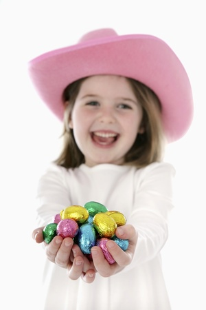 Girl with chocolate eggs  Stock Photo - 13558160