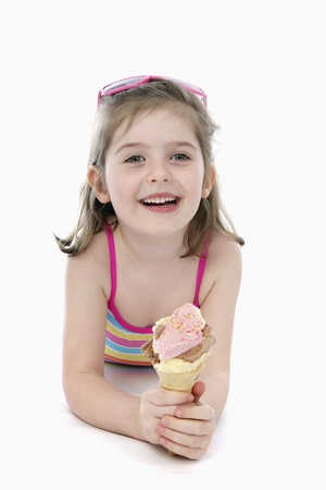 Girl in swimwear holding ice-cream photo