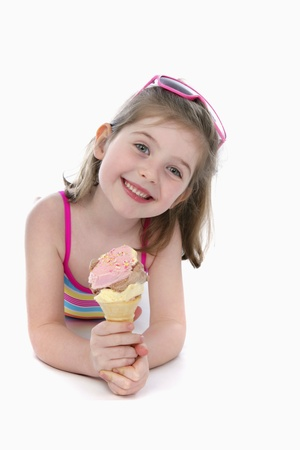Girl in swimwear holding ice-cream Stock Photo - 13558155