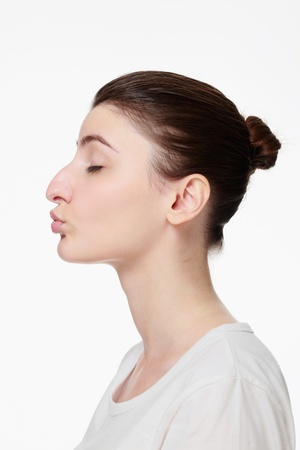 Woman puckering her lips with eyes closed Stock Photo - 14658634