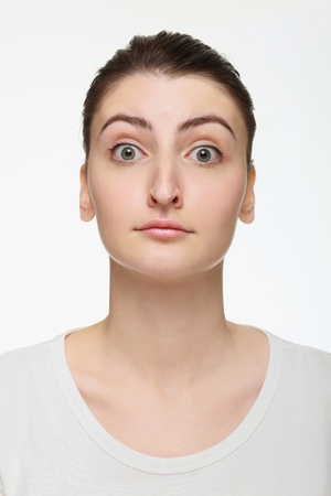 Woman with eyes wide opened photo