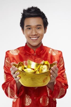 Man holding gold ingots Stock Photo - 17128870