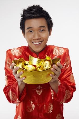 Man holding gold ingots