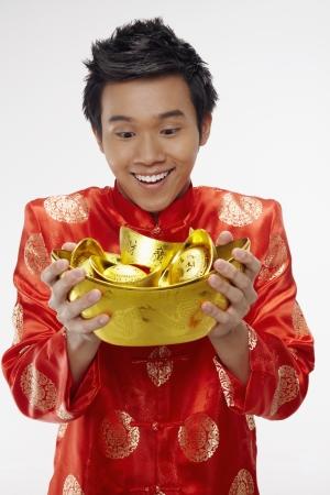 Man holding gold ingots Stock Photo - 17128872