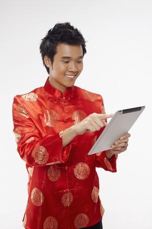 Man using digital tablet Stock Photo - 17128867