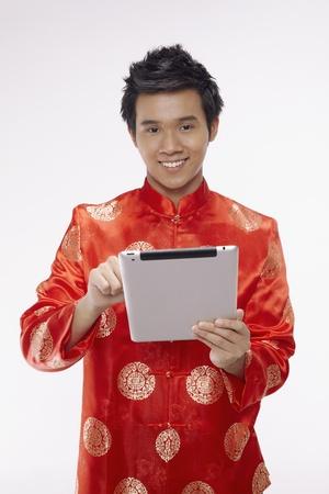 Man using digital tablet Stock Photo - 17128873