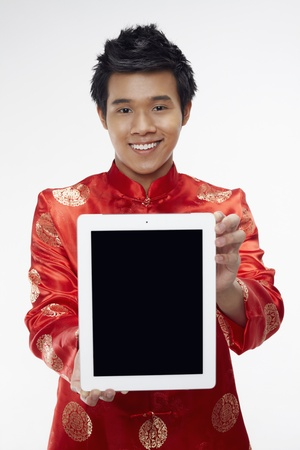 Man holding out digital tablet  Stock Photo - 17130016