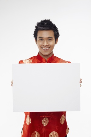 Man holding up a white cardboard Stock Photo - 17130005