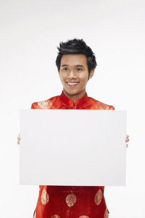 Man holding up a white cardboard  Stock Photo - 17130007
