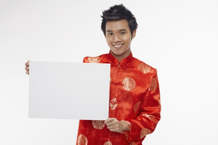 Man holding up a white cardboard  Stock Photo - 17130018