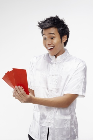 Man holding out red packets Stock Photo - 17130013