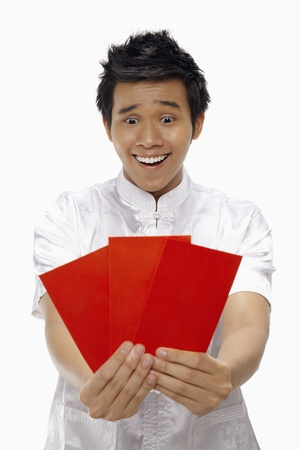 Man holding out red packets Stock Photo - 17130006