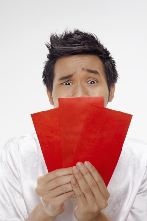 Man holding out red packets  Stock Photo - 17130023