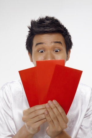 Man looking at red packets  Stock Photo - 17130020