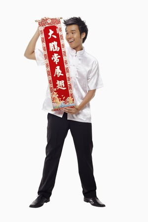Man holding a banner with Chinese New Year greeting  Stock Photo - 17130001