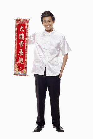 Man holding a banner with Chinese New Year greeting  Stock Photo - 17130002