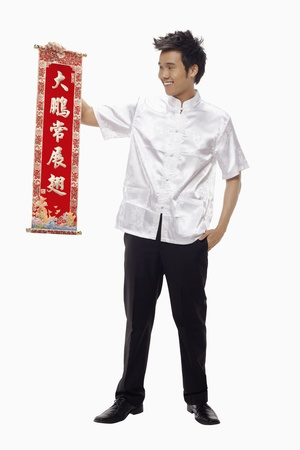 Man holding a banner with Chinese New Year greeting Stock Photo - 17130003